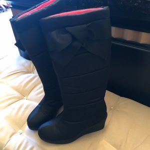 Black Kate Spade quilted boots